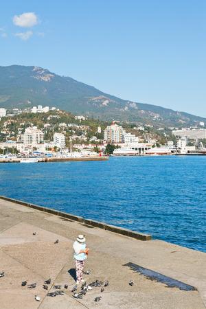 crimean: YALTA, RUSSIA - SEPTEMBER 30, 2014: people on waterfront of Yalta city in Crimea in September . Yalta is resort city on the north coast of the Black Sea on the Crimean peninsula.