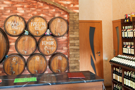 crimean: YALTA, RUSSIA - SEPTEMBER 2, 2014: local crimean wine on tap in wine shop in Yalta, Crimea. Winemaking in Crimea has existed for over two thousand years