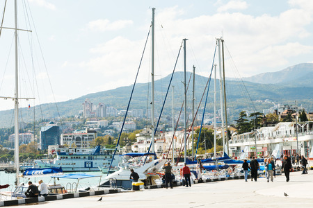 crimean: YALTA, RUSSIA - SEPTEMBER 28, 2014: people on waterfront in Yalta city in September . Yalta is resort city on the north coast of the Black Sea on the Crimean peninsula.
