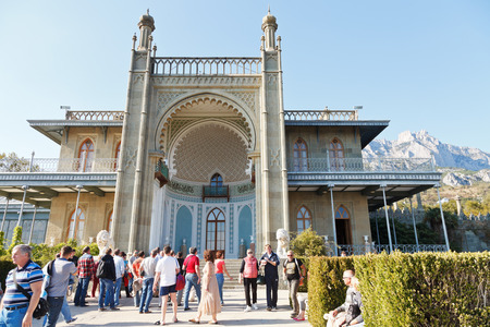 alupka: ALUPKA, RUSSIA - SEPTEMBER 28, 2014: tourists near south entrance facade of Vorontsov (Alupka) Palace in Crimea. The palace was built between 1828 and 1848 for Prince Vorontsov. Editorial
