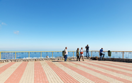 crimean: YALTA, RUSSIA - SEPTEMBER 29, 2014: Tourists in observation place on Ai-Petri mountain plateau in Crimea. On a clear day sight range up to 135 km from Ai-Petri mountain - to the middle of Black Sea Editorial