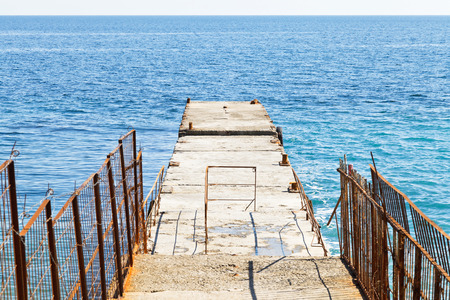 pier - breakwater in Black Sea on waterfront of Yalta city, Crimea photo