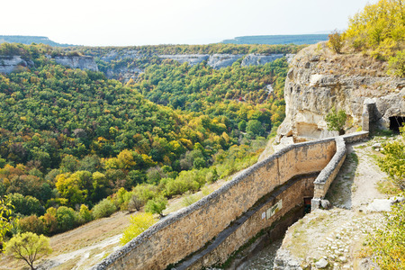 view of gorge mariam-dere and wall of chufut-kale town in Crimean mountains in autumn photo