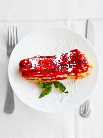 top view of dessert eclair on white plate photo