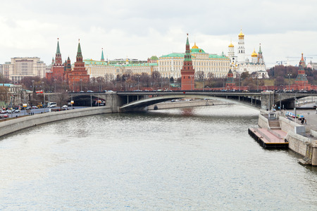 Moskva River, Bolshoy Kamenny Bridge, Kremlin in Moscow in autumn day photo