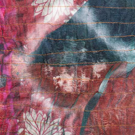 square pattern on stitched silk batik close up