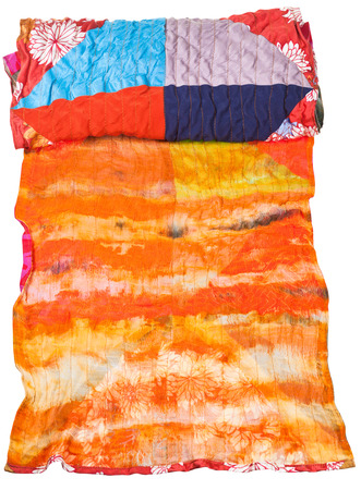 rolled silk batik and patchwork scarf isolated on white background photo