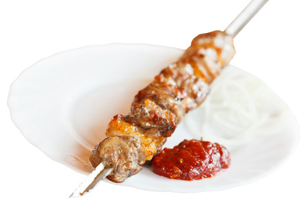 skewer with lamb shish kebab on white plate isolated on white background photo