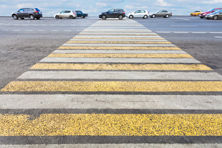 yellow and white pedestrian crossing on road photo