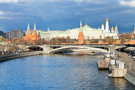 moskva river: dark blue clouds over illuminated Moscow Kremlin and Moskva River in autumn day Stock Photo