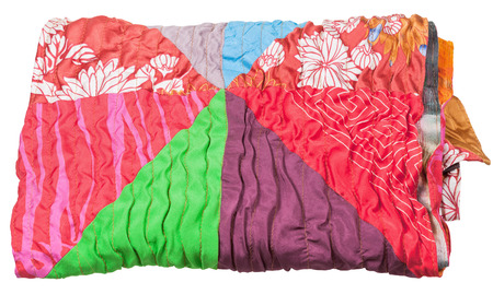 neckcloth: rolled patchwork scarf isolated on white background Stock Photo