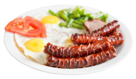 fried eggs, sausages, tomato, beans on plate isolated on white background photo