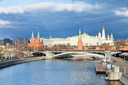 sunshine illuminates sofiyskaya embankment of Moskva River and Moscow Kremlin in autumn day
