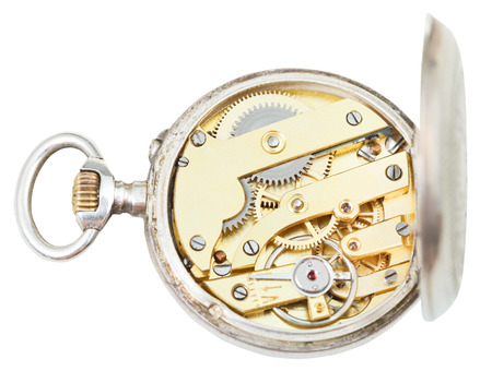 above view of brass clockwork of retro silver pocket watch isolated on white background photo