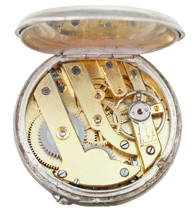 brass movement of retro silver pocket watch isolated on white background photo