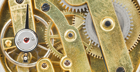 background from brass mechanical clockwork of retro watch close up photo