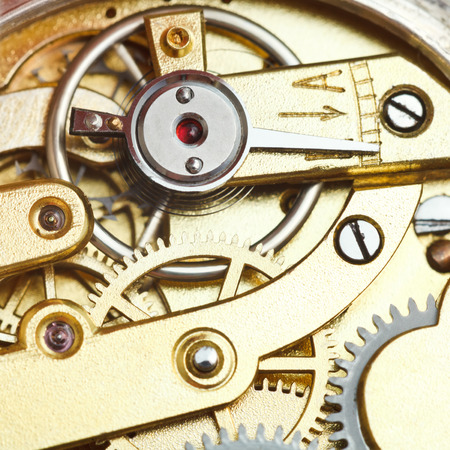 brass mechanical clockwork of retro watch close up photo