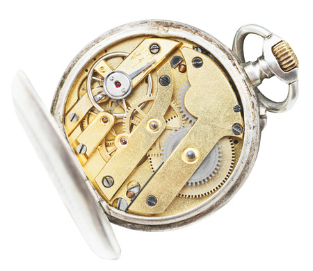 above view of brass movement of vintage pocket watch isolated on white background photo