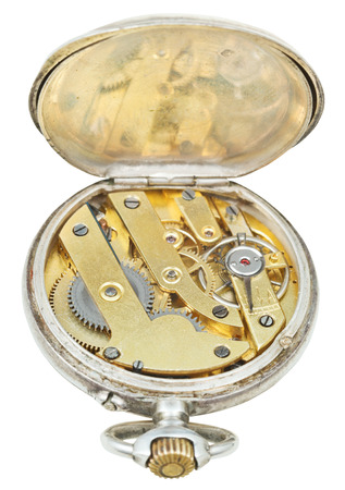 brass clockwork of retro silver pocket watch isolated on white background photo