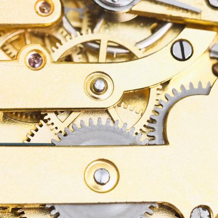 gears of brass mechanical clockwork of retro watch close up photo