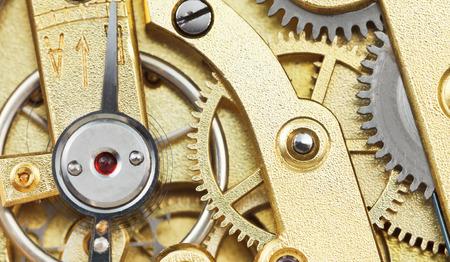brass mechanical movement of vintage clock close up photo