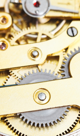 background from brass mechanical clockwork of vintage clock close up photo