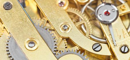 background from brass gear clockwork of retro watch close up photo