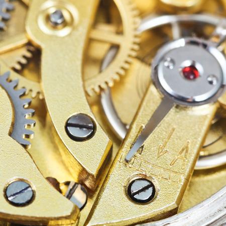 brass mechanical movement of retro clock close up photo