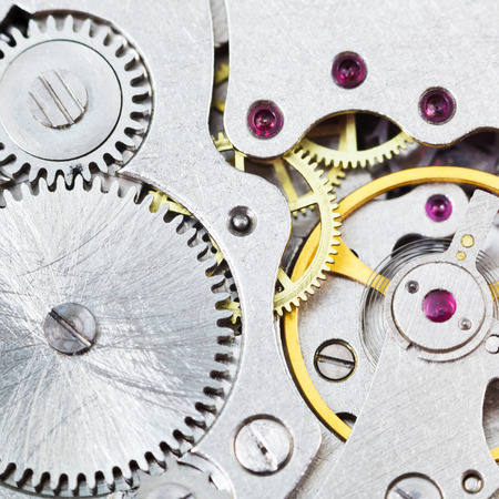 background from steel mechanical movement of vintage watch close up photo