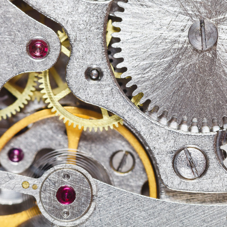 background from steel mechanical movement of vintage clock close up photo