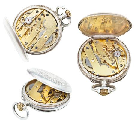 set of open retro pocket clockworks isolated on white background photo