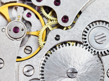 background from steel mechanical clockwork of vintage watch close up photo