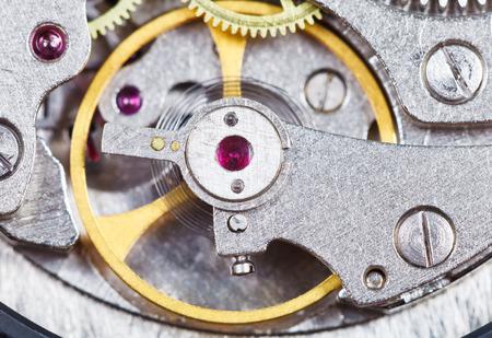 steel mechanical movement of retro watch close up photo