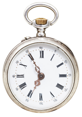 seven o'clock: five minutes to seven oclock on the dial of retro pocket watch isolated on white background Stock Photo