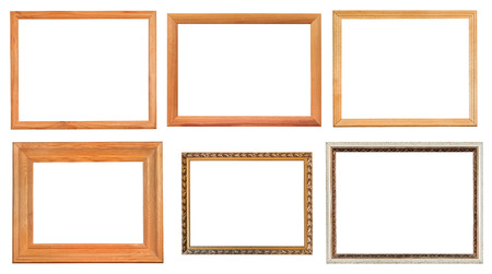 set of different wooden picture frames with cut out canvas isolated on white background photo