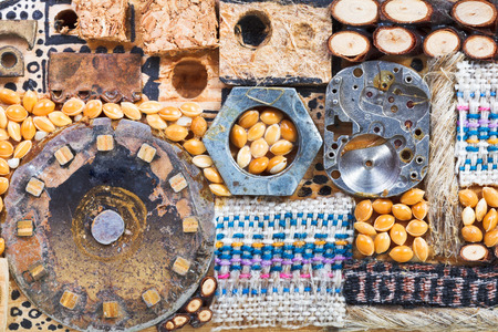 abstract set of natural and mechanical objects close up glued to wooden board photo