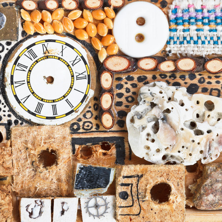 abstract still life from natural and sewing objects close up glued to wooden board photo