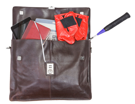 open leather briefcase with business and sport things isolated on white background photo