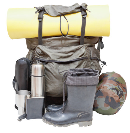 sleeping bag: set of camping equipment with backpack, rolled sleeping pad, boots, thermos, knife, flask, can, sleeping bag isolated on white background