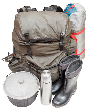 primus: set of expedition equipment with backpack, tent, pot, rubber boots, thermos, gas burner isolated on white background