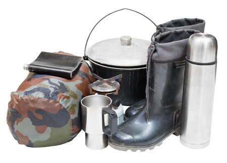 set of tourism equipment with rubber boots, pot, thermos, flask, can, sleeping bag, gas burner isolated on white background photo