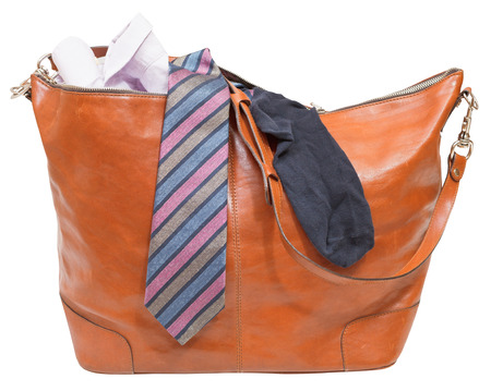 leather bag with shirt, tie, sock isolated on white background photo