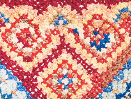 skillfully: vintage knitting craftsmanship - cross stitch embroidery close up