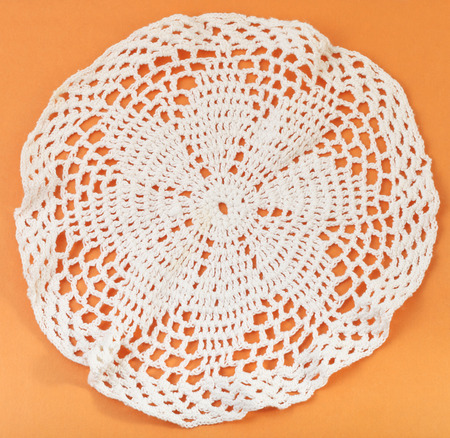 skillfully: vintage knitting craftsmanship - lace placemat embroidered by crochet Stock Photo