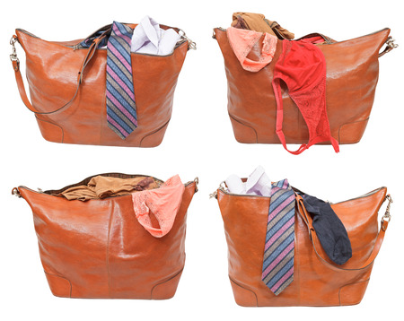 set of leather handbags with female and male clothes isolated on white background photo