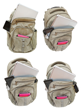 set of backpacks with mobile devices isolated on white background photo