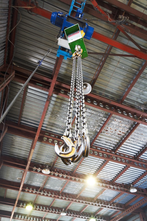 weigher: hooks of weigher bridge crane in hangar warehouse