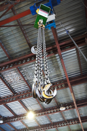 weigher: hooks of weigher overhead crane in hangar warehouse Stock Photo