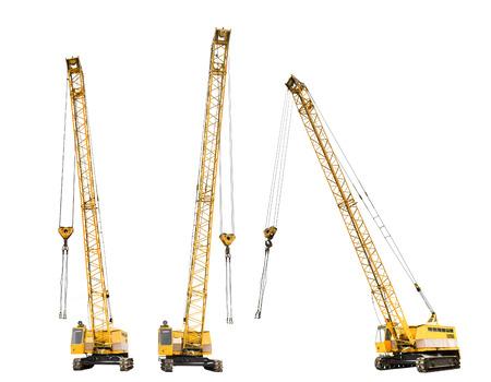 set of construction yellow crawler cranes isolated on white background