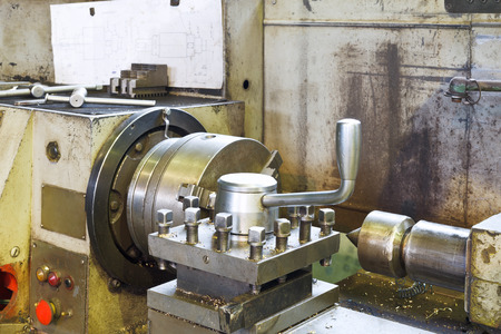 turning operation: spindles of metal lathe machine in turning workshop